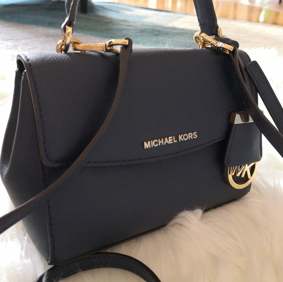 Michael Kors Handbags - Authentic Michael Kors cross body bag